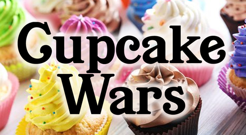 Two cupcakes having a sword fight.