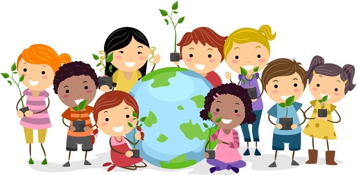 Smiling children hold up plants while gathered around a large globe showing the Earth.