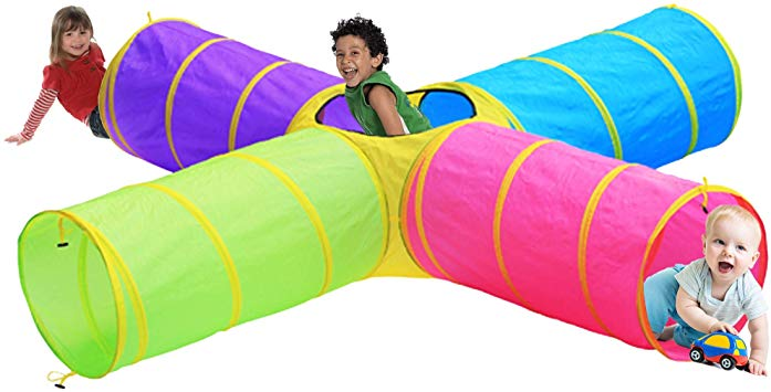 Three smiling kids play in a colorful fabric tunnel. The tunnel has four sections and an top opening in the middle. The section colors are blue, purple, pink, and green.