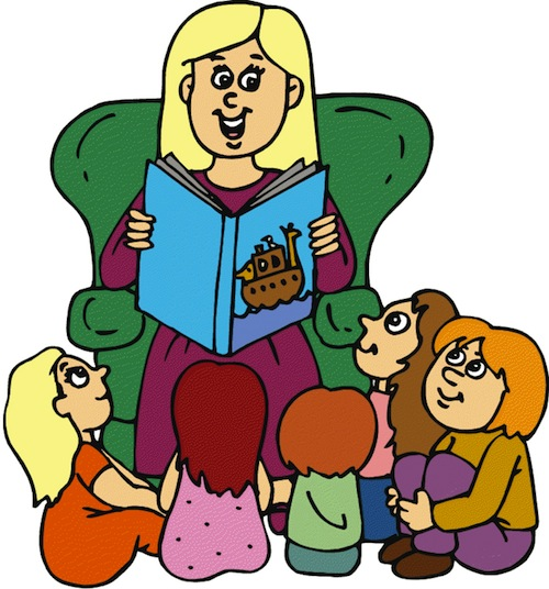 A group of children sit around a librarian, who is reading a book to them. One child sits in her wheelchair.