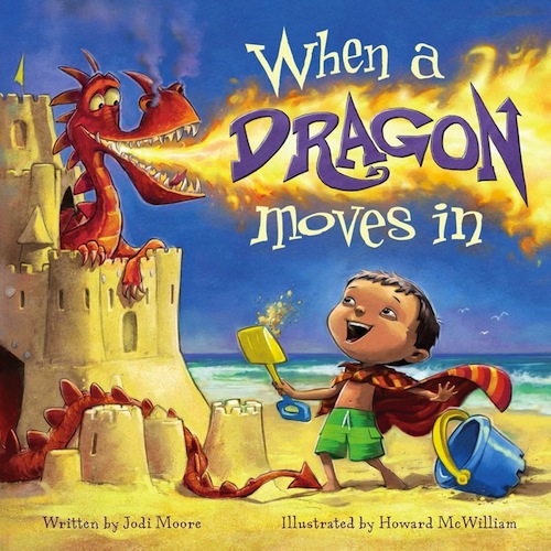 When A Dragon Moves In bok cover. A smiling boy on a beach works on a sand castle with a shovel and pail. A happy dragon coming out of the castle is breathing fire.